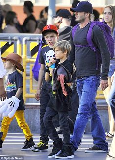 Beckham and his boys. It is so sweet how much time he spends with them!