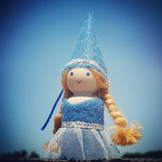 Our adorable peg doll princess is perfect for little hands. Standing at 2 1/2 inches tall, she is dressed in a blue princess dress with a cute princess hat. She would make a lovely party favor, or swe