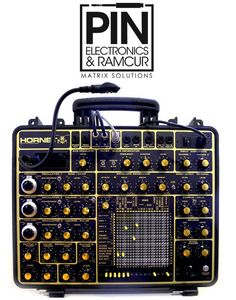 The Hornet A handmade classical portable modular synthesizer with subtractive / FM analogue synthesis based on Derek Revell's phutney boards.