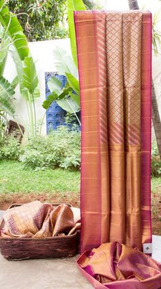 This purple kanchivaram silk, with a tinge of pink in the weave, has gold and silver zari work all over. The border has gold zari with a hint of cherry red, while the gold pallu enhances the visual...