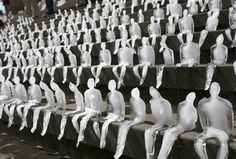 Small ice figures are seen on the stairs of Gendarmenmarkt in Berlin, Germany, Wednesday, Sept. 2, 2009, as part of an art project by World Wide Fund for Nature. Around one thousand ice figures by Brasilian artist Nele Azevedo were melting within 30 minutes symbolizing the effect of global warming. (AP Photo/Maya Hitij)