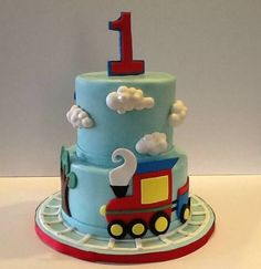 Train and clouds first birthday cake