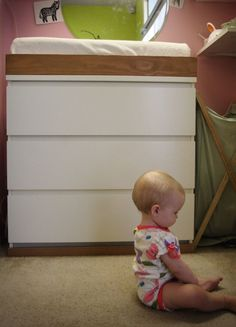 built a changing pad topper to the 3 drawer malm dresser...  that would raise our malm to the right diaper changing height!!