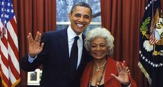 """The President and Lieutenant Uhura give the Vulcan salute. """"Live long and prosper!"""""""