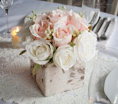 A perfect rustic rose wedding centerpiece for your special day! Romantic blush pink and ivory roses are accented with soft green berries, and sit in a rustic bi