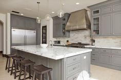 While this kitchen island with cabinets on both sides is definitely a spectacular piece, it's also a functional fixture of the kitchen as well. With its cabinets, it adds extra storage space, and provides extra dining area with seating option