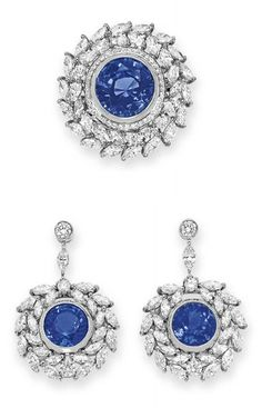 D DIAMOND JEWELRY, BY TIFFANY & CO.   Comprising a pair of ear pendants, each set with a bezel-set circular-cut tanzanite, weighing approximately 4.24 and 3.90 carats, within a marquise and circular-cut diamond surround, from a marquise-cut diamond link, to the collet-set diamond surmount; and a ring en suite, set with a bezel-set circular-cut tanzanite, weighing approximately 6.65 carats, mounted in platinum, ear pendants with English hallmarks and maker's mark  Each signed Tiffany & Co.