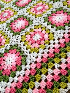 My first Flower Garden Blanket – Lovely pinks and greens. I made this blanket – for the most part – in my car in the car-rider line, picking up my eldest from school. I used the S…