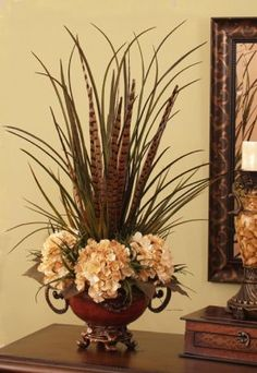 This beautiful and unique design is created with bunches of grasses, feathers and cream hydrangea. MAKE THIS FOR MOM'S SMALL TABLE WITH DRAWER IN CORNER ARCHWAY--USE MY METAL VASE