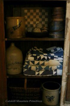Wow! How great is this? Blue quilts and old salt glazed crocks...