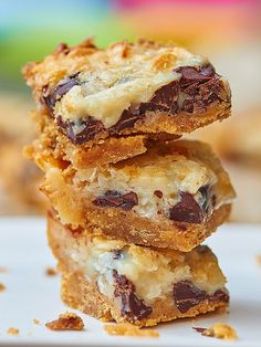 These ugly duckling bars may not be much to look at, but they sure taste good! Start with a graham cracker crust and pile on gooey chocolate chips, sweet coconut flakes, and sweetened condensed milk! showmetheyummy.com #bars #dessert #chocolatechips #coconut #sweetenedcondensedmilk
