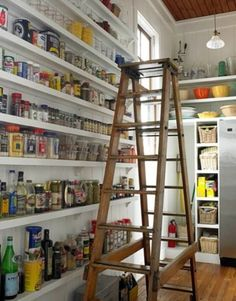 Another amazing pantry storage space.  Narrow shelves from floor to ceiling with a beautiful ladder.