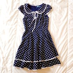 Modcloth Minuet Navy Polka Dot Dress SMALL Super cute Modcloth Polka dot navy dress with Peter Pan collar. Features Layered, lightly ruffled hem, cap sleeves and tied keyhole neckline joining the collar. Measurements: 33.5 in long. ModCloth Dresses