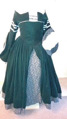 """(SOLD) Full 1550's Diane de Poitiers Gown Pittsburgh, Pennsylvania $300  Worn twice, this handmade replica is for sale at a steal of $300. It contains 7 yards of hunter green velvet (yes, the real stuff). Corset, hoopskirt and unconventioal but functional farthingale included. Fits a 5'4"""" 180lb woman comfortably, with plenty of space in the lacing for a heavier woman. Headpiece with black silk veil not pictured but included. Shipping is estimated at $40."""