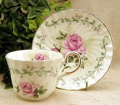 Beautiful Cream-Colored Tea Cup And Saucer With Large Roses And Leaf Design