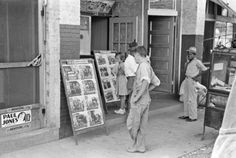 by Russell Lee - Children in front of moving picture show, Alpine, Texas, 1939