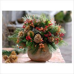 Winter arrangement.  Pine cones, berries, holly & greens
