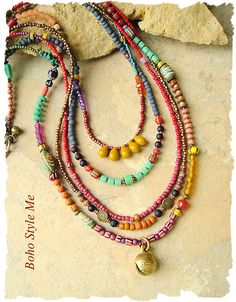 Global chic – This layered beaded necklace is full of character, color and textures – with a unique boho tribal style. You will find gemstones, hidden among the menagerie of glass beads, including, amber and amethyst. Throughout the five strands, you will find trade beads, mustard glass teardrops, striped gooseberry beads, glass discs, frosted glass, chevron beads, terra clay beads, krobo beads, matte glass beads and an endless amount of glass seed beads. Topping off the strands is are…