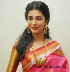 Shruti Hassan in antique gold Nakshi balls haram featuring temple design pendant and antique earrings adorned with pearl chains. Related PostsTemple Jewellery StylesSamantha in Antique Ruby JewelleryElegant Nakshi Peacock Necklace and JhumkasBaby Sara in Temple JewelleryShruti Hassan in Antique Peacock JewelleryAnu Prabhakar in Temple Jewellery