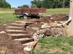Railroad tie timber steps filled with pea gravel. (Outdoor, exterior, landscaping, stairs)
