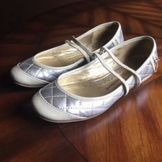 Juicy Couture Magda Quilted Ballet Flat Rounded toe design. Metallic silver finish with cream detailing. Gold tone hardware. Juicy Couture Shoes