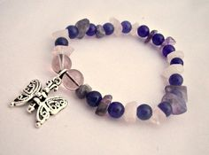£6.50 Pregnancy, Amethyst, Rose Quartz and Butterfly Charm Bracelet    This cute little purple and pink charm bracelet has been made especially for pregnant women. It is Amethyst and Rose Quartz precious stone chips beaded on a stretchy cord bracelet, perfect for when water retention starts to kick in!