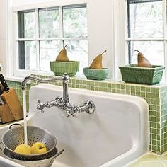 Kitchen Sink Remodel Past Perfect, Southern Living Magazine Sources: love the green tiles and old school country sink - It's where we cook, eat, entertain, and even do homework. Get inspired by these beautiful spaces. 1930s Kitchen, Farmhouse Sink Kitchen, Farm Sink, Kitchen Backsplash, New Kitchen, Vintage Kitchen, Kitchen Decor, Farmhouse Style, Vintage Farmhouse