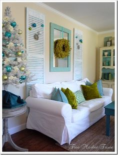 Shabby Chic - reclaimed shutters and mirror behind the couch. (The turquoise and green Christmas decor is nice, too!) Flea Market Trixie via House of Turquoise. I love the wreath Deco Pastel, Sunroom Windows, House Of Turquoise, Turquoise Room, Christmas Interiors, Wood Shutters, Interior Decorating, Interior Design, Beach Cottages