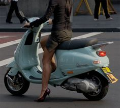 Ciao! Ciao! Fashionable only in Italy, women on bikes and wearing dresses....and.....high heels.....amazing!