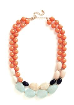 Bevy of Baubles Necklace. Bring a plethora of irresistible charm to a boho-inspired ensemble with this pastel statement necklace! #coral #modcloth