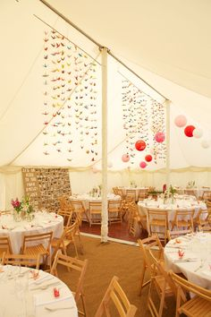 King poles draped in white, 1000 origami birds, hanging lanterns, coir matting flooring, wooden chairs and white table cloths Origami Boat, Kids Origami, Origami Birds, Marquee Decoration, Origami Decoration, Hanging Decorations, Hanging Lanterns, Paper Lanterns, 21st Birthday Decorations