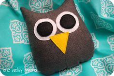 Gavin loves stuffies and I have tons of felt and scraps of fabric so I might have to make a few girl and boy owls with these.  Thinking about owl thing for little miss's nursery too when that comes about.