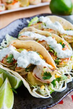 Cilantro Lime Shrimp Tacos with Roasted Corn Slaw and Roasted Jalapeno Crema.