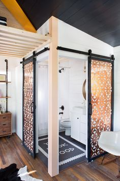 Kim Lewis Designs designed bathroom barn doors built out of Parasoleil copper panels. Hardware was purchased at Rustica Hardware.