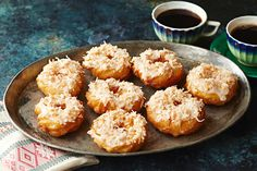 Learn how to make scrumptious, coconut-kissed Churro Donuts at home with your deep fryer. You may never buy store-bought donuts again!