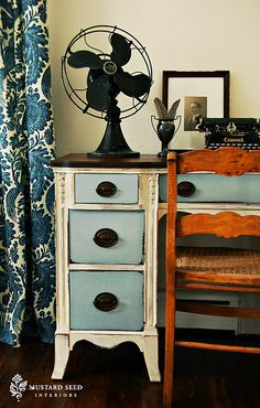 love the painted desk with wood tones, and the use of vintage pieces