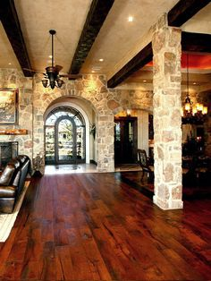 Living Room accented with solid wood beams and hand scrapped Mesquite wood flooring by Zbranek & Holt Custom Homes, Lake Travis and Austin Luxury Custom Home Builder
