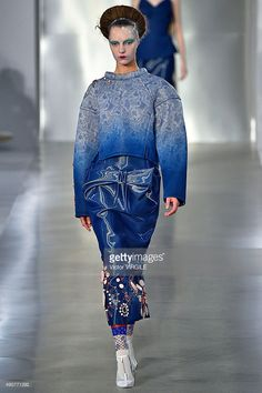 A model walks the runway during the Maison Margiela Ready to Wear show as part of the Paris Fashion Week Womenswear Spring/Summer 2016 on September 30, 2015 in Paris, France.