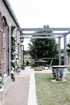 Love this patio space. A bit of cover over the pergola and I wouldn't move very far!