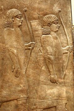 Ashurbanipal's guards preceding the wheeled throne bearers. Gypseum alabaster relief from Ashurpanipal's palace at Niniveh, ca. 645 BC.