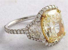 7.04 tcw Fancy Light Yellow cushion-cut Diamond Ring