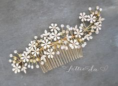 This wedding hair vine is a lovely finishing touch for the boho chic bride. This hand-wired hair vine set on a wire comb, combines white enamel metal leaves and flowers, natural seed pearls, clear beads and crystals to create a center flower design. SHIPPING TIMES and more ITEM DETAILS: Please read below  ITEM DETAILS: - Hand-wired; piece is bendable allowing for flexible placement. - Beaded sprays at either end can be stretched out or curled up to suit your style. You must secure ends with…
