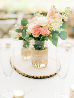 Shabby chic mason jar burlap lace wedding Centerpiece on wood slice filled in with pretty flowers #centerpieces #masonjars #weddingcenterpieces