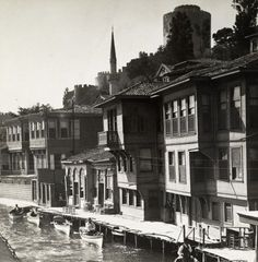 Waterfront homes and rowboats along the Bosporus below Rumeli Hisari, Istanbul