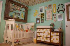 I love the wallpapered dresser. #yellow #baby #nursery