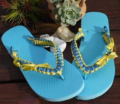 Turquoise Flip Flops with blue and yellow satin ribbon hand wrapped. Visit us at www.facebook.com/yarnandwire