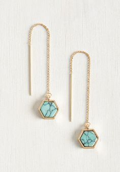 In your morning hustle, you always find the time to adorn your ensemble with this perfect pair of threaded earrings. Boasting a faux-turquoise stone in a glistening, golden hexagon, each geometric accessory adds the perfect touch of glam for the girl on the go!