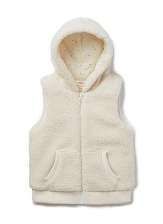 100% Polyester Vest. Fluffy sherpa vest, with hood and 100% Cotton lining. Sleeveless, with zip through front & 1x1 rib hem. Regular fitting silhouette. Available in Cream.