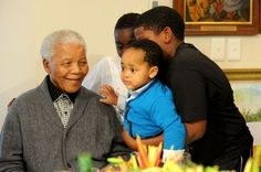 Madiba smiles at his great-grandson  Zesilo Hlongwane, on his 94th Birthday