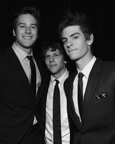 jesse eisenberg, andrew garfield, and armie hammer image